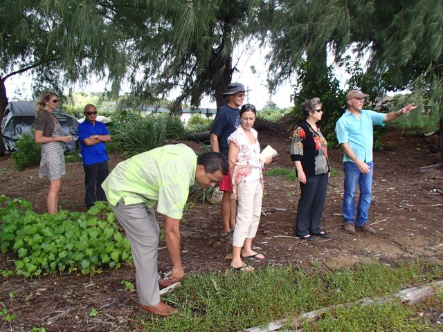 DLNR visits on Sept. 24, 2015. First Deputy Kekoa Kaluhiwa checks out the akulekule while Carl Berg explains the Puali Wetland to Chair Suzanne Case.